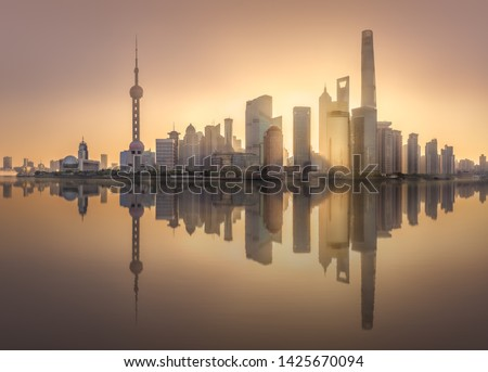 Sunrise scenery view of Shanghai skyline and Huangpu river with reflection of sun on buildings, China #1425670094