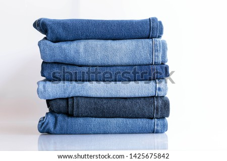 Jeans trousers stack on white background  #1425675842