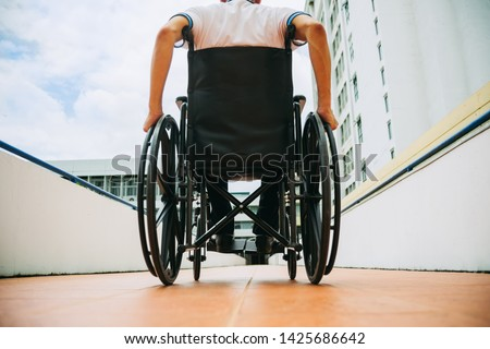 People with disabilities can access anywhere in public place with wheelchair,that make them independent in transportation and feel they are not the stranger from social. Royalty-Free Stock Photo #1425686642
