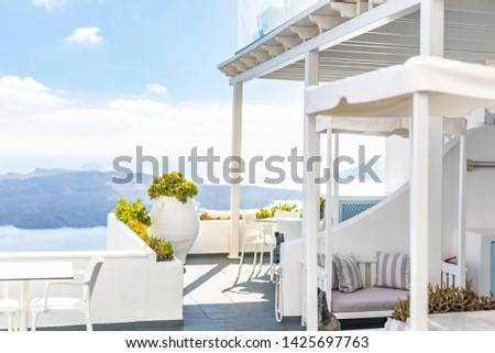 Greece, romantic Santorini landscape volcano caldera island in Aegean sea. View from town Oia. Day sunny scenery. White architecture, summer vacation and travel concept #1425697763
