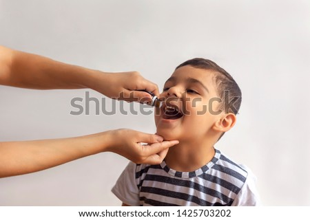 Child immunization with little drop in clinic. Doctor providing immunization vaccines for the immune system of infant. Child's Immunization, Children's Vaccination, Health conception. #1425703202