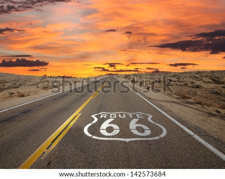 Route 66 pavement sign sunrise in California's Mojave desert. Royalty-Free Stock Photo #142573684