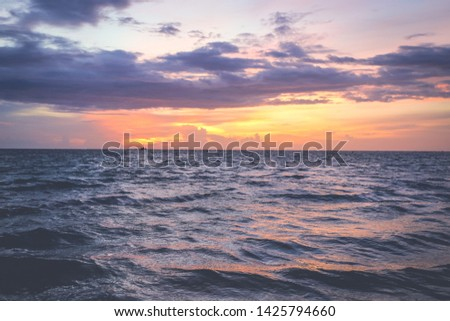 Storm clouds, storm passing over ocean, dramatic clouds after storm at sunset, coast line in Koh Phangan, Thailand #1425794660