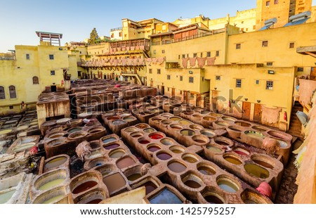 Sightseeing of Morocco. Tanneries of Fez. Dye reservoirs and vats in traditional tannery of city of Fez, Morocco #1425795257