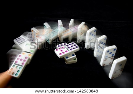 Domino Falling Effect on Black Background