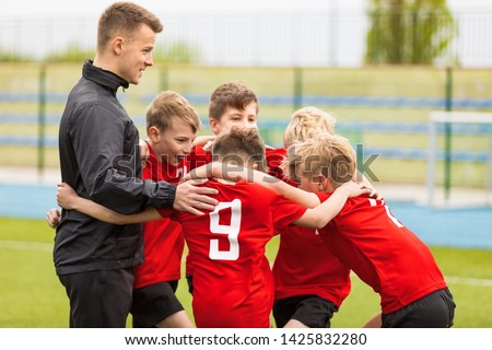 Coaching Youth Sports. Kids Soccer Football Team Huddle with Coach. Children Play Sports Game. Sporty Team United Ready to Play Game. Youth Sports For Children. Boys in Sports Jersey Red Shirts #1425832280