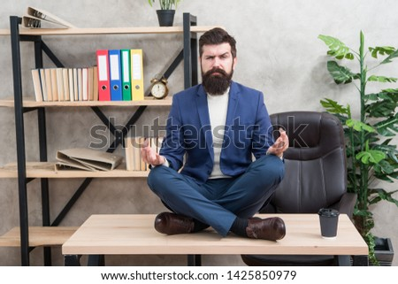Prevent professional burnout. Way to relax. Meditation yoga. Self care. Psychological help. Relaxation techniques. Mental wellbeing and relax. Man bearded manager formal suit sit lotus pose relaxing. #1425850979