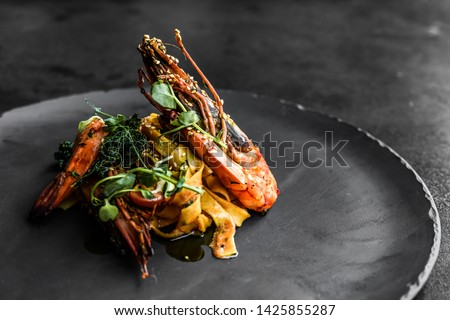 food fish elegant gourmet black plate top view lunch dinnerdish meal fine dining closeup green sea seafood shrimp beautiful modern #1425855287