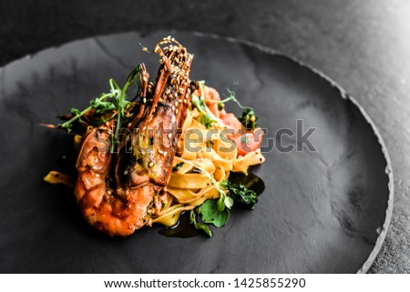 food fish elegant gourmet black plate top view lunch dinnerdish meal fine dining closeup green sea seafood shrimp beautiful modern #1425855290