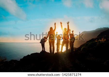 big family with kids travel in mountains at sunset #1425871274