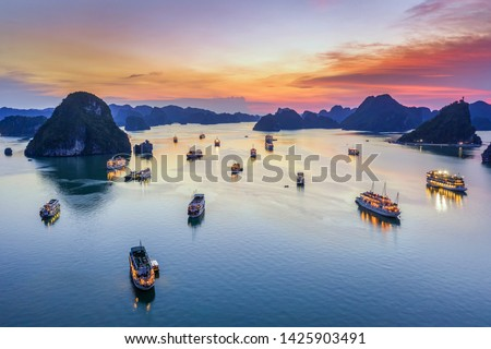 Aerial view floating fishing village and rock island, Halong Bay, Vietnam, Southeast Asia. UNESCO World Heritage Site. Junk boat cruise to Ha Long Bay. Popular landmark, famous destination of Vietnam #1425903491