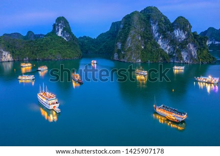 Aerial view of sunset, dawn near Ti Top rock island, Halong Bay, Vietnam, Southeast Asia. UNESCO World Heritage Site. Junk boat cruise to Ha Long Bay. Popular landmark, famous destination of Vietnam Royalty-Free Stock Photo #1425907178