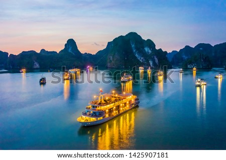 Aerial view of sunset, dawn near Ti Top rock island, Halong Bay, Vietnam, Southeast Asia. UNESCO World Heritage Site. Junk boat cruise to Ha Long Bay. Popular landmark, famous destination of Vietnam Royalty-Free Stock Photo #1425907181