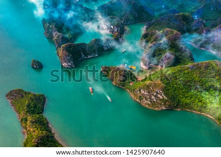 Aerial view of Sang cave and Kayaking area rock island, Halong Bay, Vietnam, Southeast Asia.UNESCO World Heritage Site. Junk boat cruise to Ha Long Bay. Popular landmark, famous destination of Vietnam #1425907640