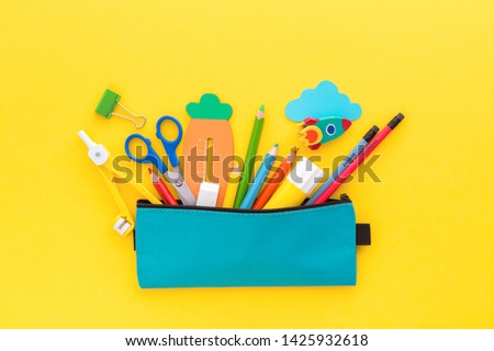 Back to school concept. Pencil case with school stationery on a yellow background.  Royalty-Free Stock Photo #1425932618