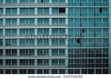 The texture of the wall of a modern house with lots of windows #1425936185