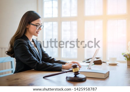 Asian business lawyer woman working with computer laptop in legal office.Law and Legal services concept. #1425958787