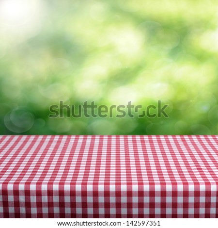 Empty table and defocused foliage green background. Great for product display montages.