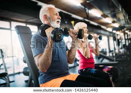 Happy senior people doing exercises in gym to stay fit #1426125440