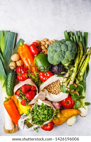 Balanced vegetarian food background. Vegetables, fruits, nuts, sprouts, seeds, chickpeas on a white background, top view. #1426196006