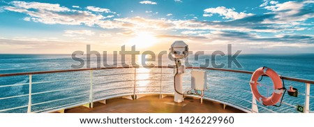 Summer cruise vacation concept. Panoramic view of the sea with a beautiful sunset just above the horizon. #1426229960