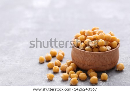 Roasted chickpeas in bowl on grey wooden table #1426243367