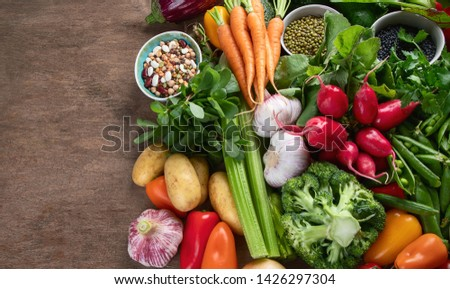 Assortment of fresh vegetables. Vegan and vegetarian diet concept. Organic local food. Top view with copy space #1426297304