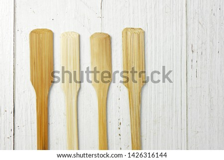Bamboo spoon on wood texture table - Image #1426316144