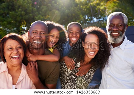 Outdoor Portrait Of Multi-Generation Family In Garden At Home Against Flaring Sun #1426338689