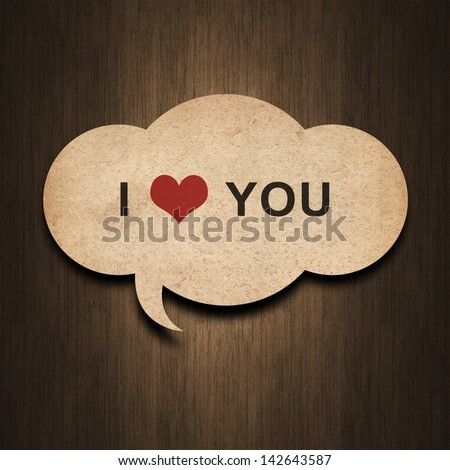 text i love you on speech bubble paper on wood background