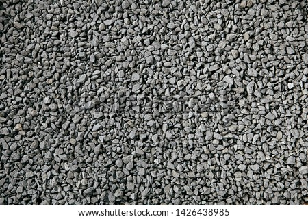 Natural Gray Granite Chippings, Macadam, Rubble or Crushed Stones Background Top View. Macro Photo of Broken Stone or Crushed Rock Texture with Place for Text #1426438985