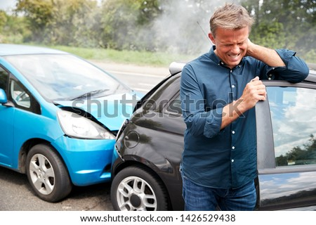 Mature Male Motorist With Whiplash Injury In Car Crash Getting Out Of Vehicle #1426529438