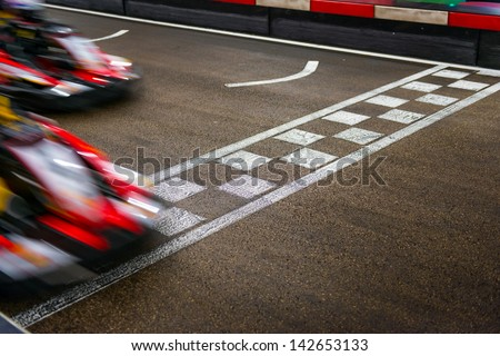 Kart crossing the finish line Royalty-Free Stock Photo #142653133