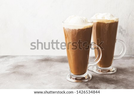 Ice coffee with ice cream on gray background. Copy space. Food background. Toned #1426534844