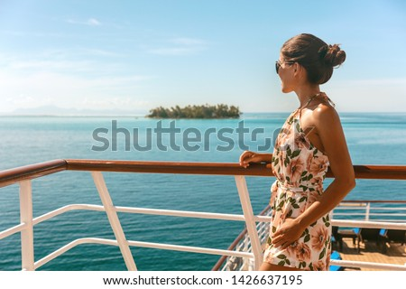 Cruise ship travel vacation luxury tourism woman looking at ocean from deck of sailing boat. Luxury Tahiti Bora Bora French Polynesia destination summer lifestyle. #1426637195