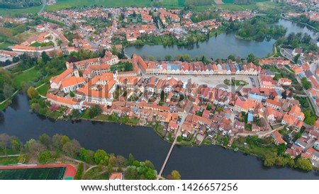 Aerial view of colorful buildings with red tile roofs at the medieval square and Old Castle in Telc in Czech Republic #1426657256