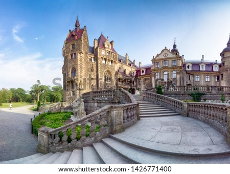 WROCLAW, POLAND - JUNE 15, 2019: Castle in Moszna near Opole, Poland. One of the most beautiful historic residences in Poland. The palace has 365 rooms and 99 towers and turrets. #1426771400