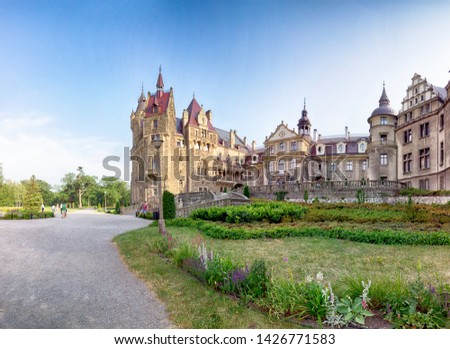 WROCLAW, POLAND - JUNE 15, 2019: Castle in Moszna near Opole, Poland. One of the most beautiful historic residences in Poland. The palace has 365 rooms and 99 towers and turrets. #1426771583