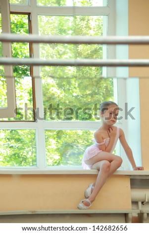 Beautiful little ballerina wearing tutu and posing on camera #142682656