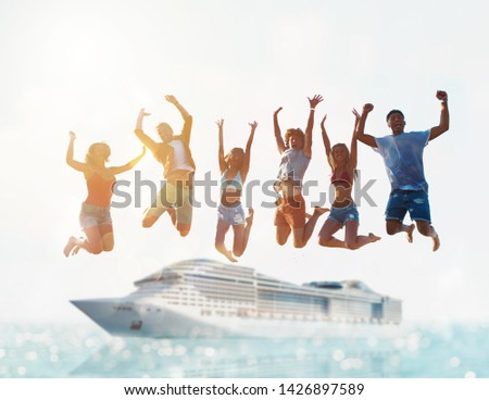 Happy smiling couples playing at the beach with cruiseship in the sea