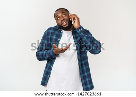Young black man smiling and talking on mobile phone. #1427023661