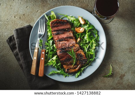 Grilled ribeye beef steak with red wine, herbs and spices. Top view. Flat lay. #1427138882