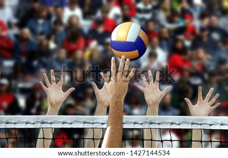 Volleyball spike with hands blocking over the net #1427144534
