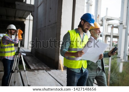 Team of architects and engineer in group on construciton site check documents and business workflow #1427148656