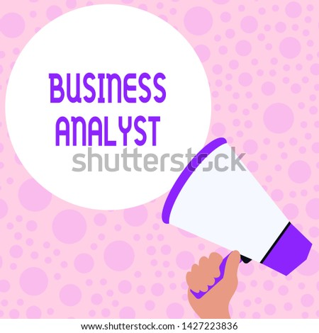 Writing note showing Business Analyst. Business photo showcasing someone who analyzes big organization or website domain Hand Holding Loudhailer Speech Text Balloon Announcement New. #1427223836