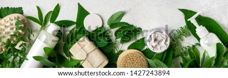 Natural cosmetics and green leaves on white stone background, banner. Natural organic skincare, bio research and healthy lifestyle concept. Royalty-Free Stock Photo #1427243894