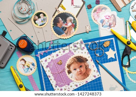 scrapbook background. the process of creating a childrens album. Card and tools with decoration  #1427248373