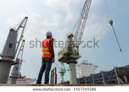 engineering foreman, controller in working place, command working area for safety and security method  #1427269286