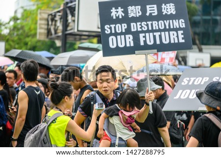 Hong Kong- 16 JUN 2019: 2 million citizens are protesting against extradition bill. A parent is protesting against Carrie Lam and the police force. #1427288795