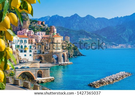 Small town Atrani on Amalfi Coast in province of Salerno, Campania region, Italy. Amalfi coast on Gulf of Salerno is popular travel and holyday destination in Italy. Ripe yellow lemons in foreground. Royalty-Free Stock Photo #1427365037